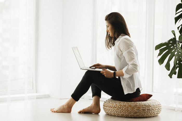 Lady working, using Gensolve Telehealth
